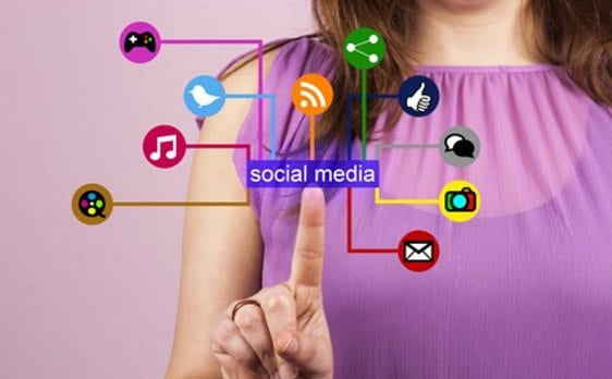Lady pressing social media marketing buttons - our services for Instagram