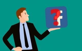 Image of male character holding Facebook logo with question mark about Should I Use Facebook Page for Business Marketing